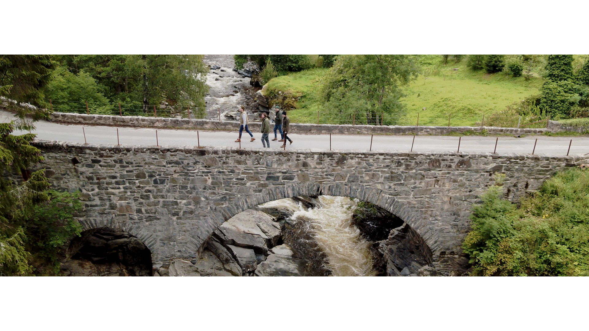 The band walking over Feshie Bridge