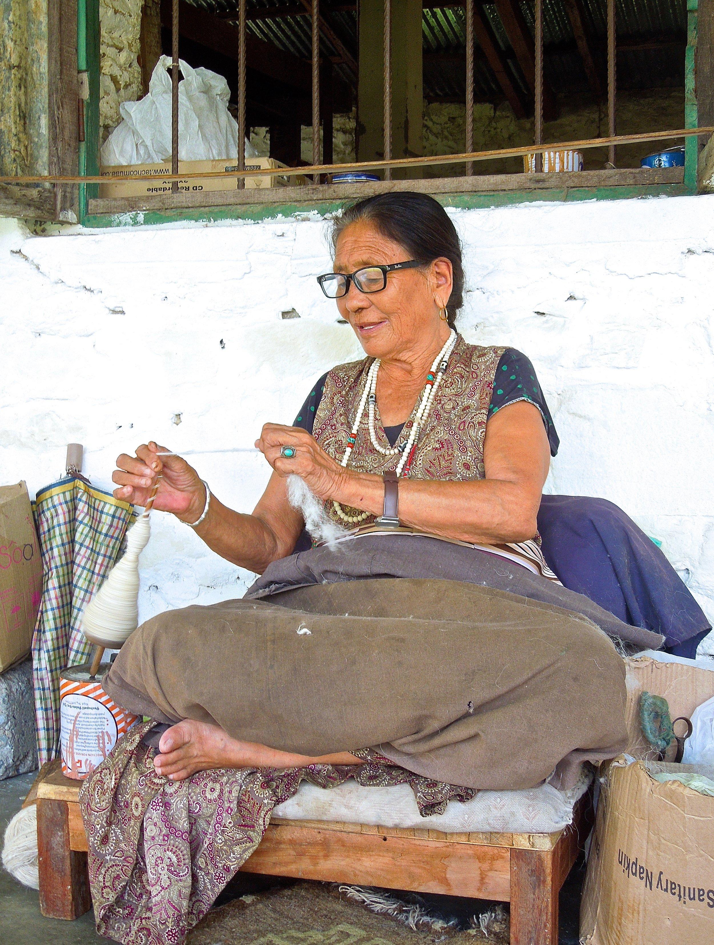 Tibetan refugee spinning yarn