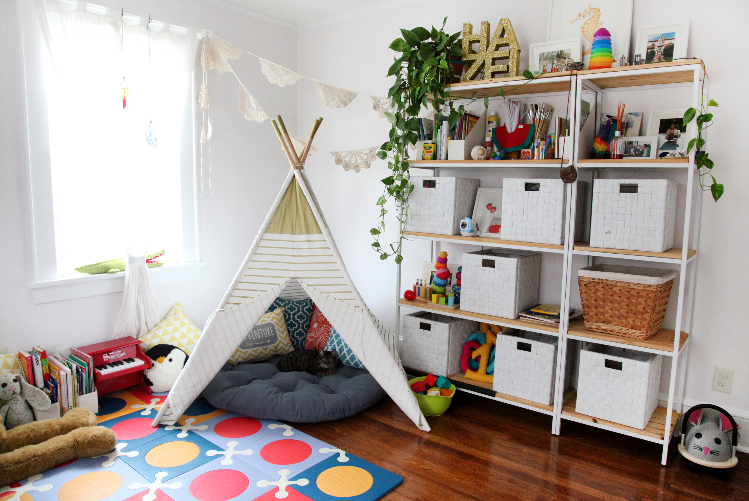 I wanted Hazel's room to be light and airy,but filled with things that inspire creativity and play. We're really good at making a mess!