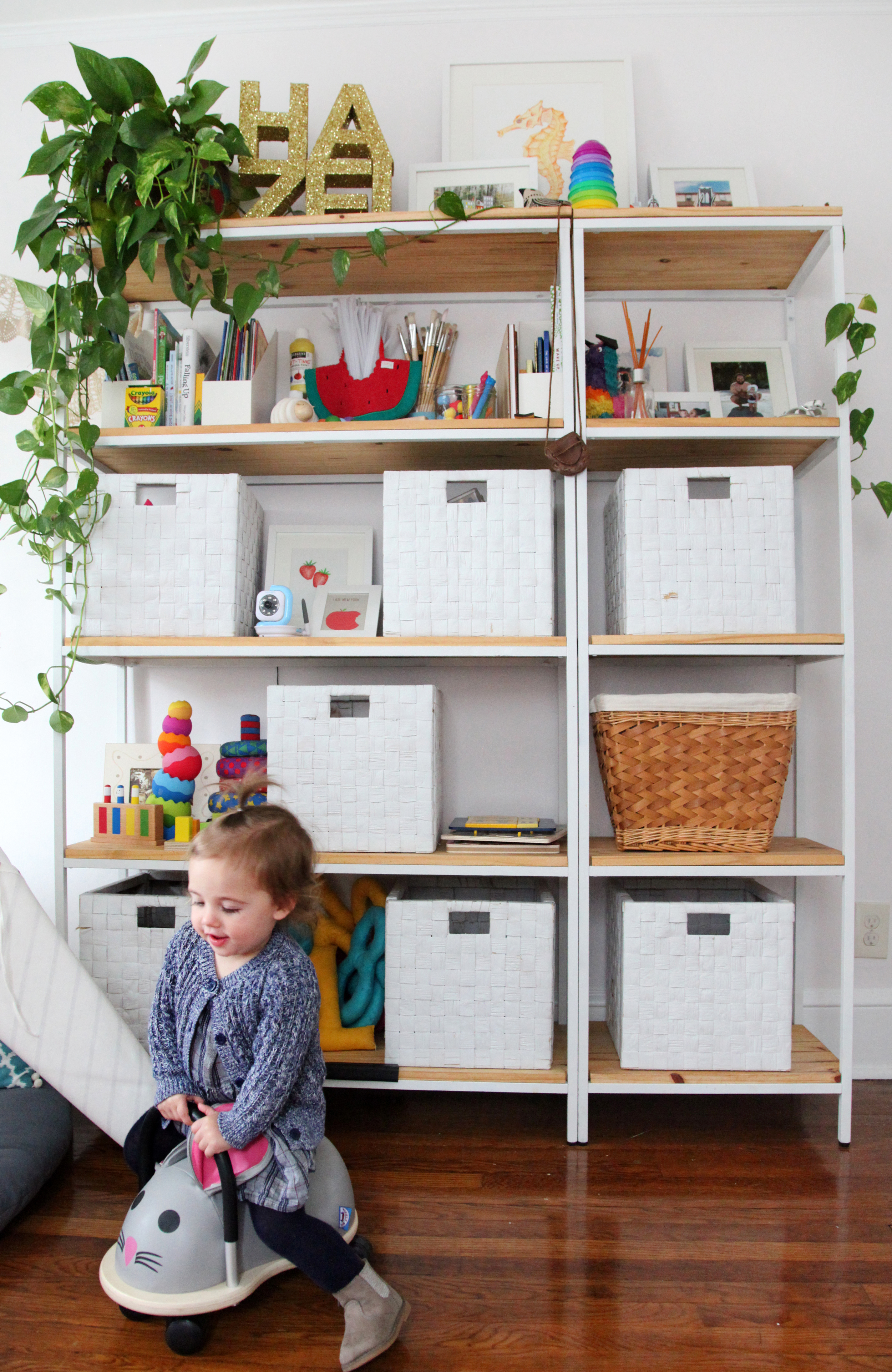 My husband, Chris and I got crafty together and made our own Ikea hack for the shelves and baskets when prepping for Hazel's arrival. I wrote about it on the blog.