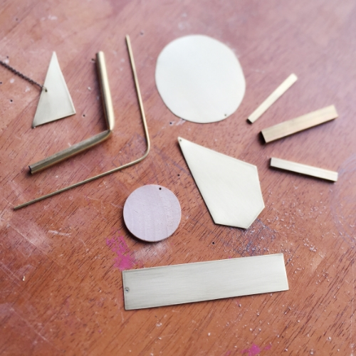 """""""An arranging of brass pieces. This is how I get my ideas; from arranging and rearranging until something comes up."""""""