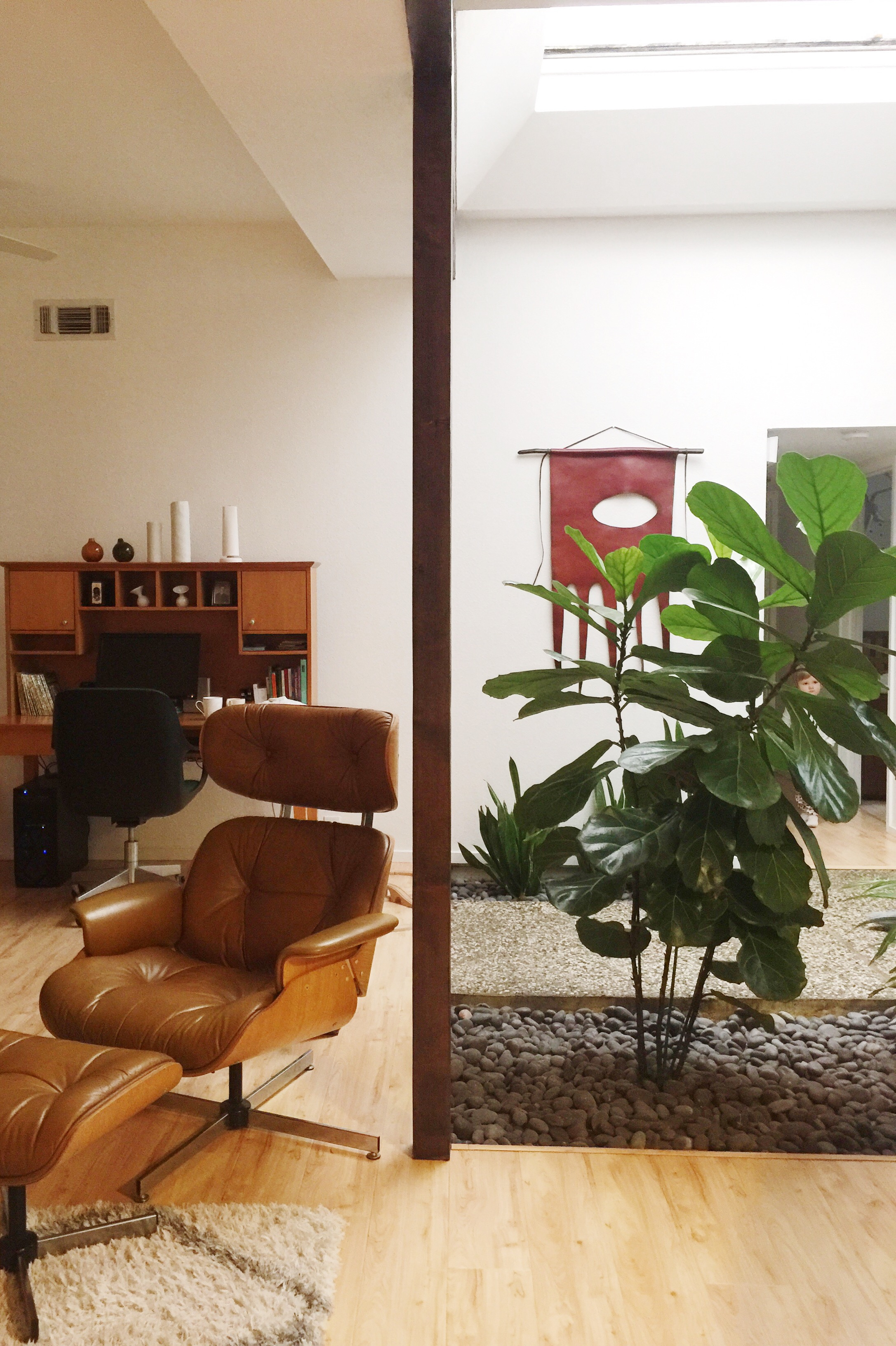 A ubiquitous teak secretary and handsome leather lounge for the ideal midcentury home.