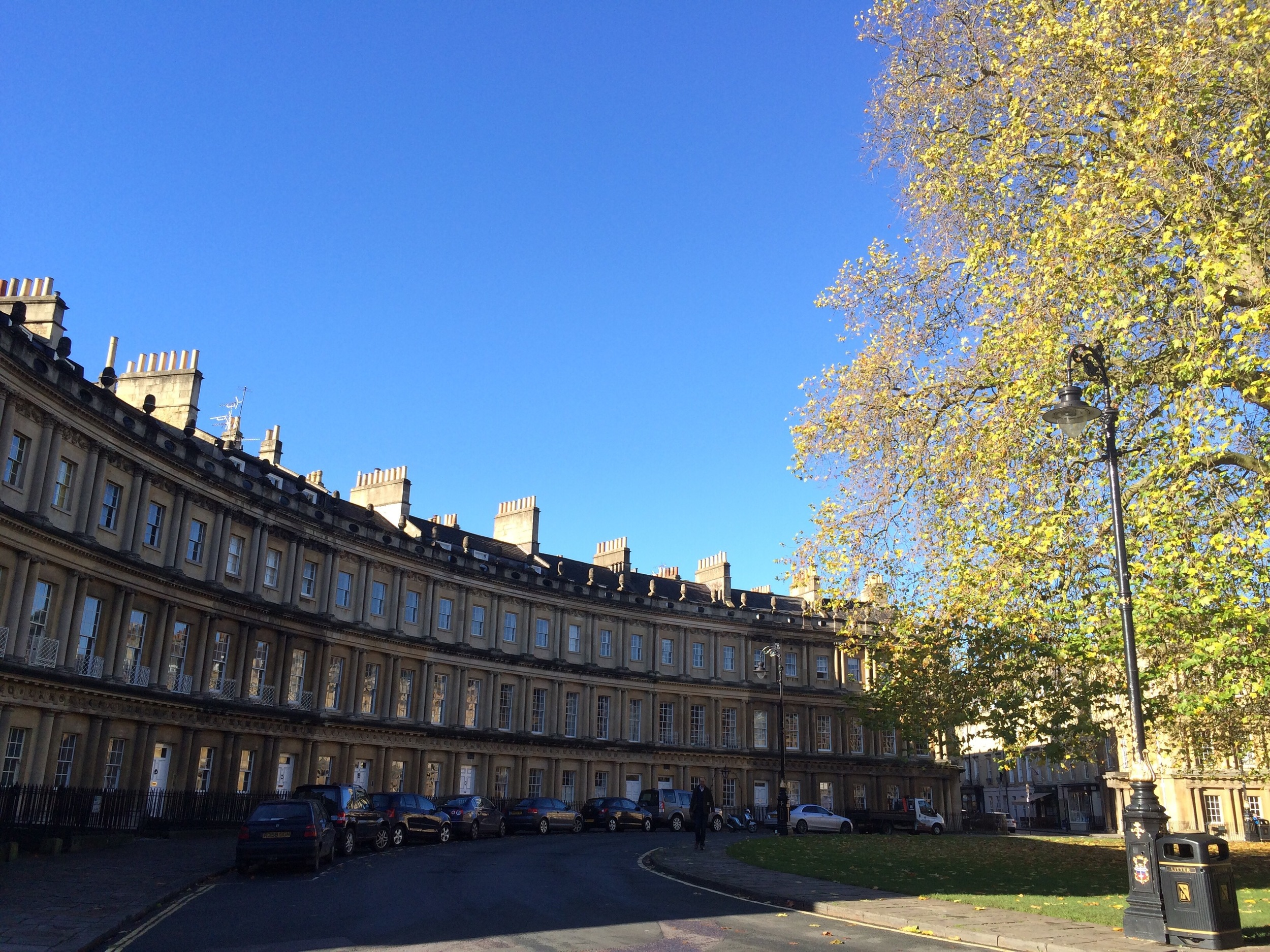 Bath is known for its Georgian architecture and natural hot springs.A proper tree-lined street with too many windows to count.