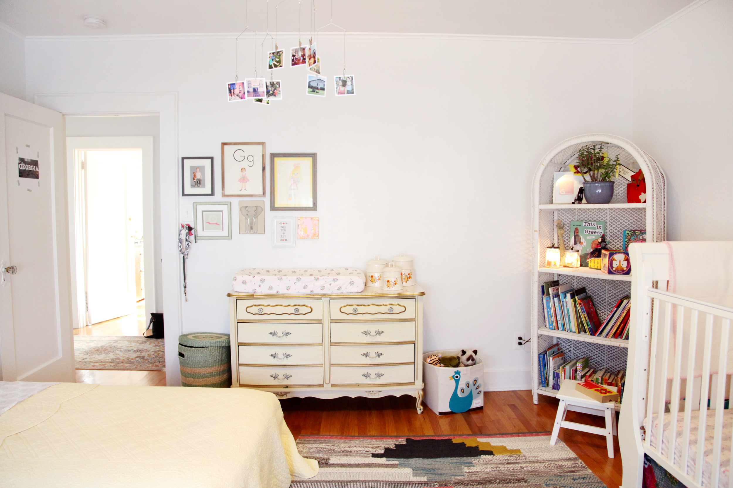 The shared room packs whimsy from wall to wall. Dressers from Dana's childhood.