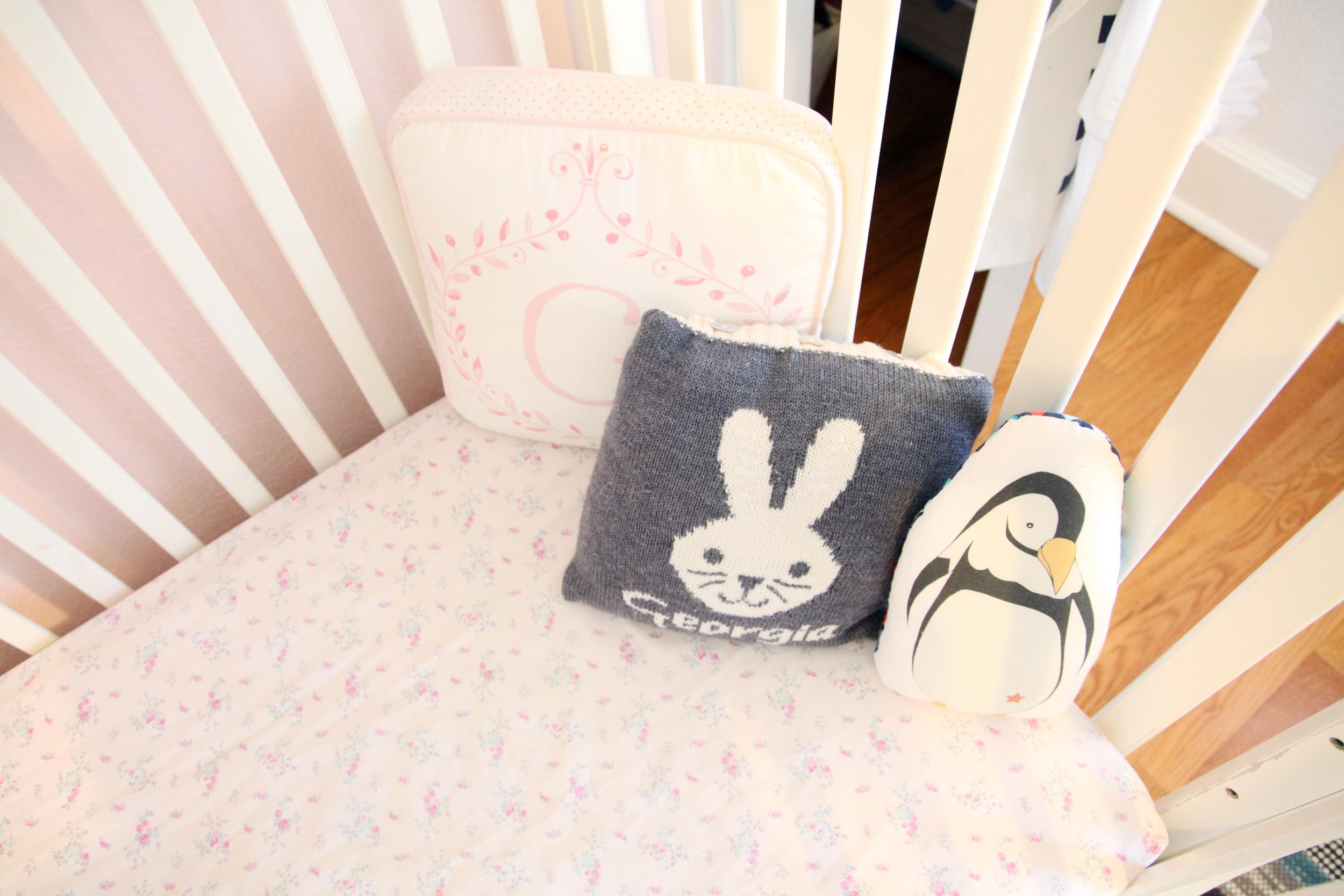 Pile of pillows in Georgia's crib.