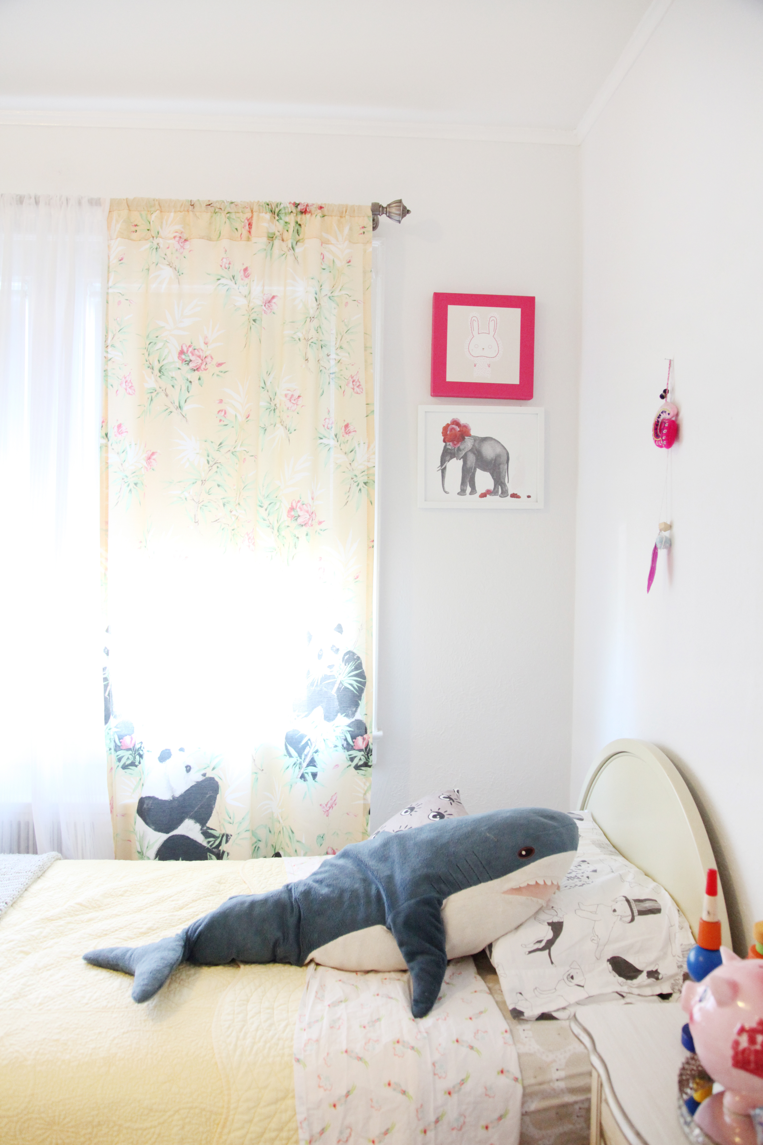 Rummage-sale panda curtains (!!), party favor decor, and a cozy shark.