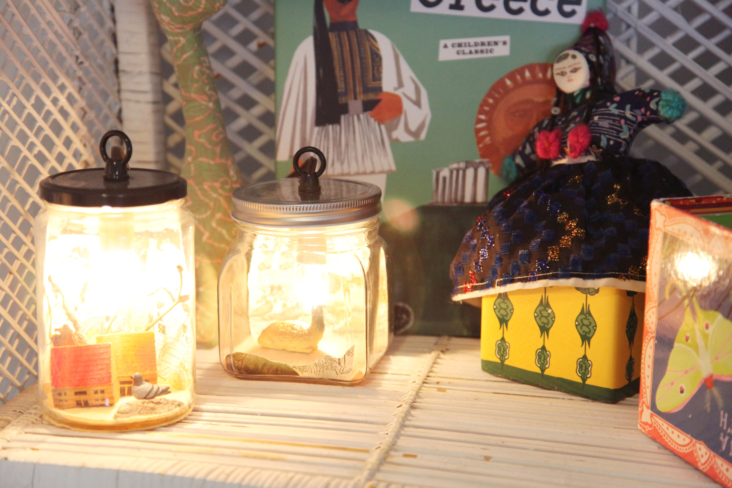 """Little diorama lanterns by   Small Home .  Dana met the creator at the Williamsburg holiday market years ago and had her make a custom lamp with a pigeon in it when she was pregnant with Georgia, who's nickname was """"Pidge"""" in utero."""