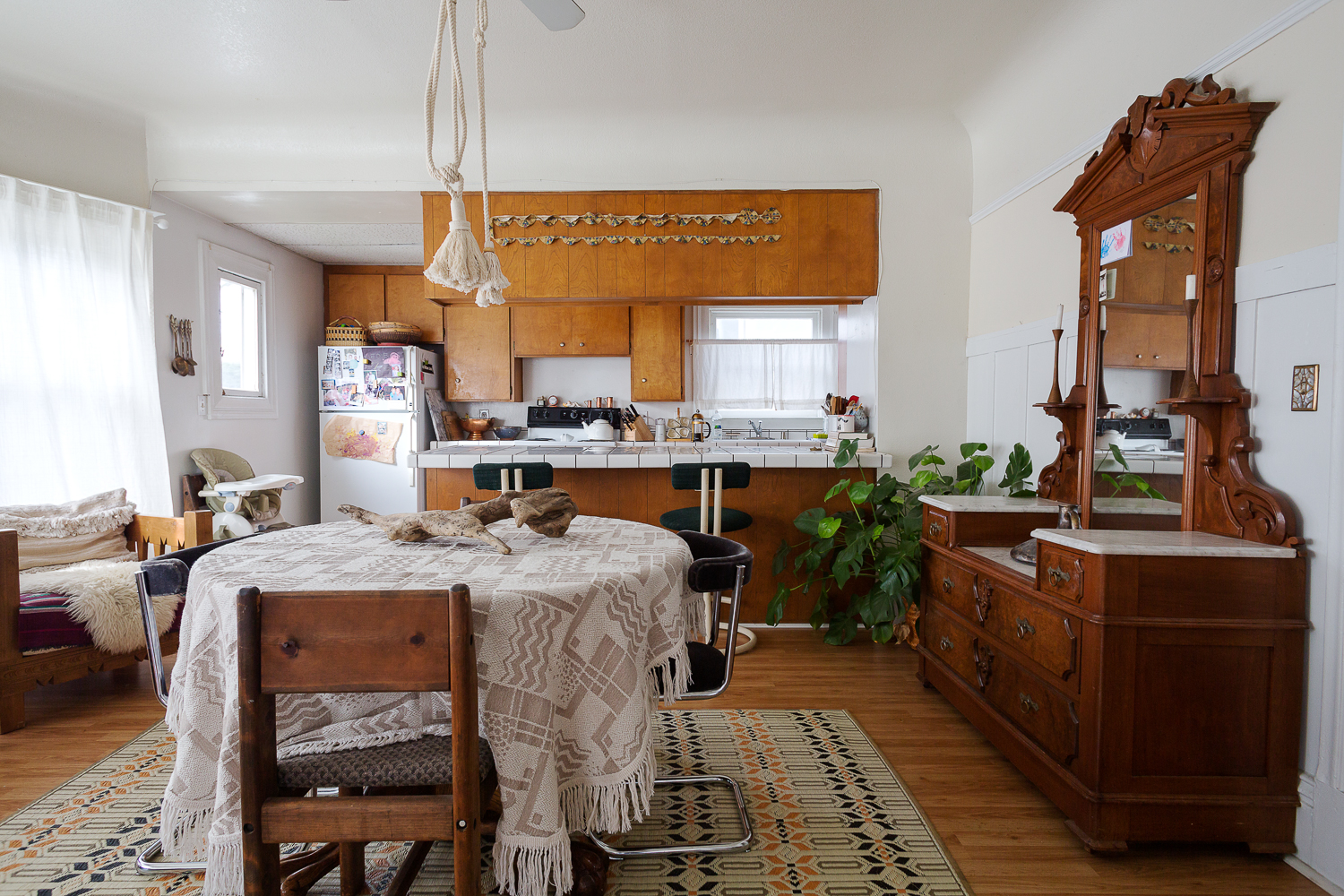 Gorgeous antiquity. Peep the vintage trimmings pinned up in the kitchen!