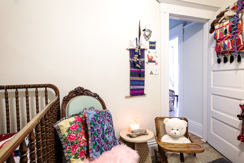 Textiles adorn Edie's nursery.