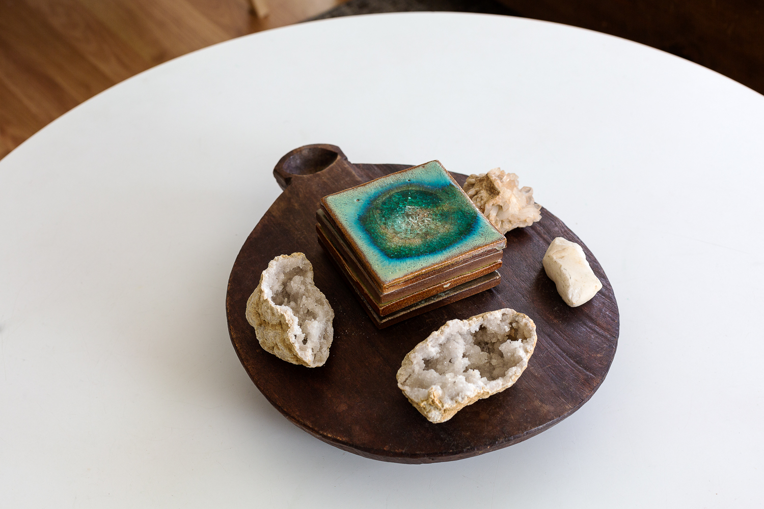 Rock-lover. A pile of   Anthropologie  coasters and some gathered geodes from travels to the ocean and Colorado.