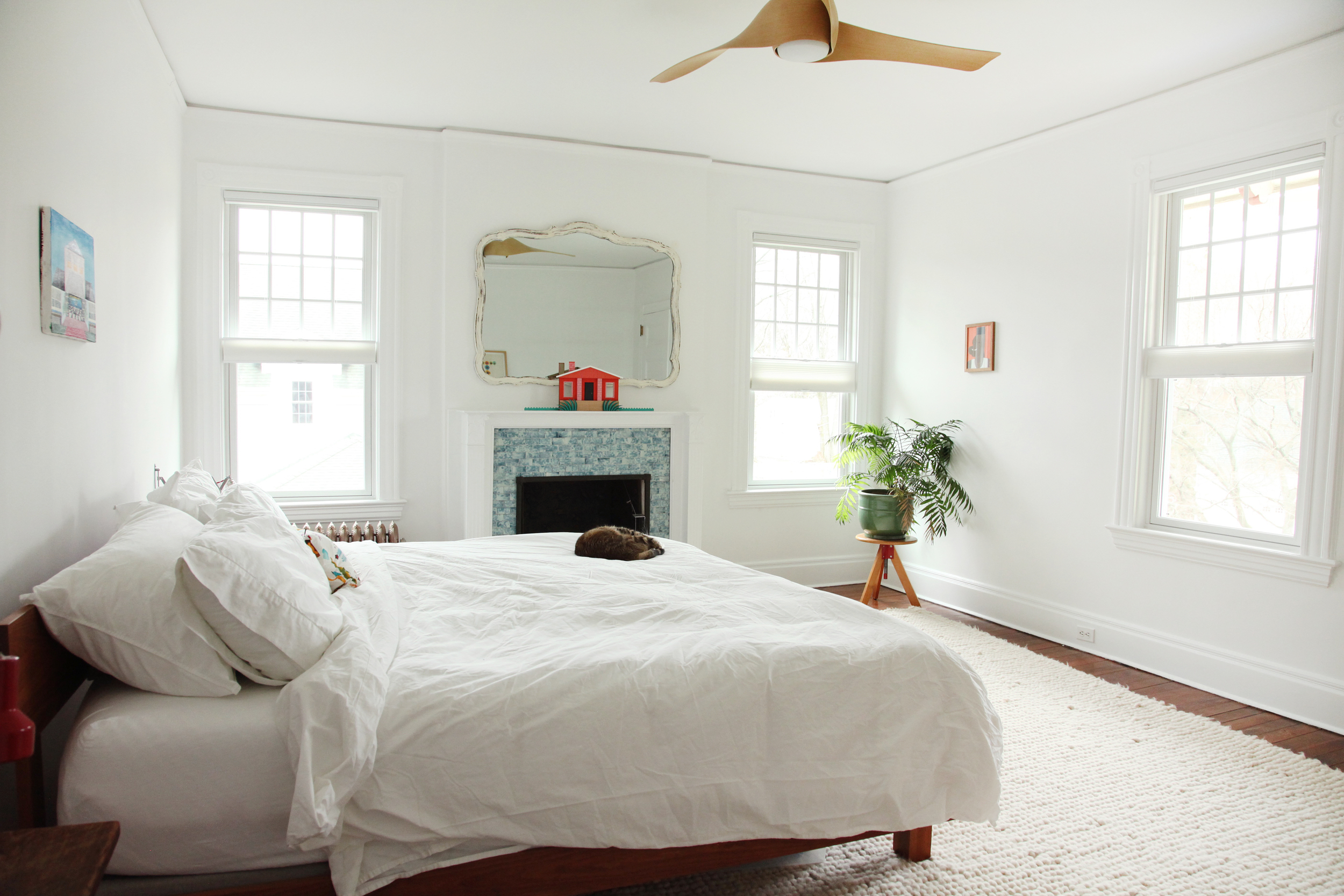 """""""I like our bedroom to be minimal, I find it soothing. The master bed is from  Room and Board  with our other cat Lloyd Christmas aka 'Panties.'Night stands are made of old barn wood that Thomas cut to size and the shelf brackets are by  Bend ."""