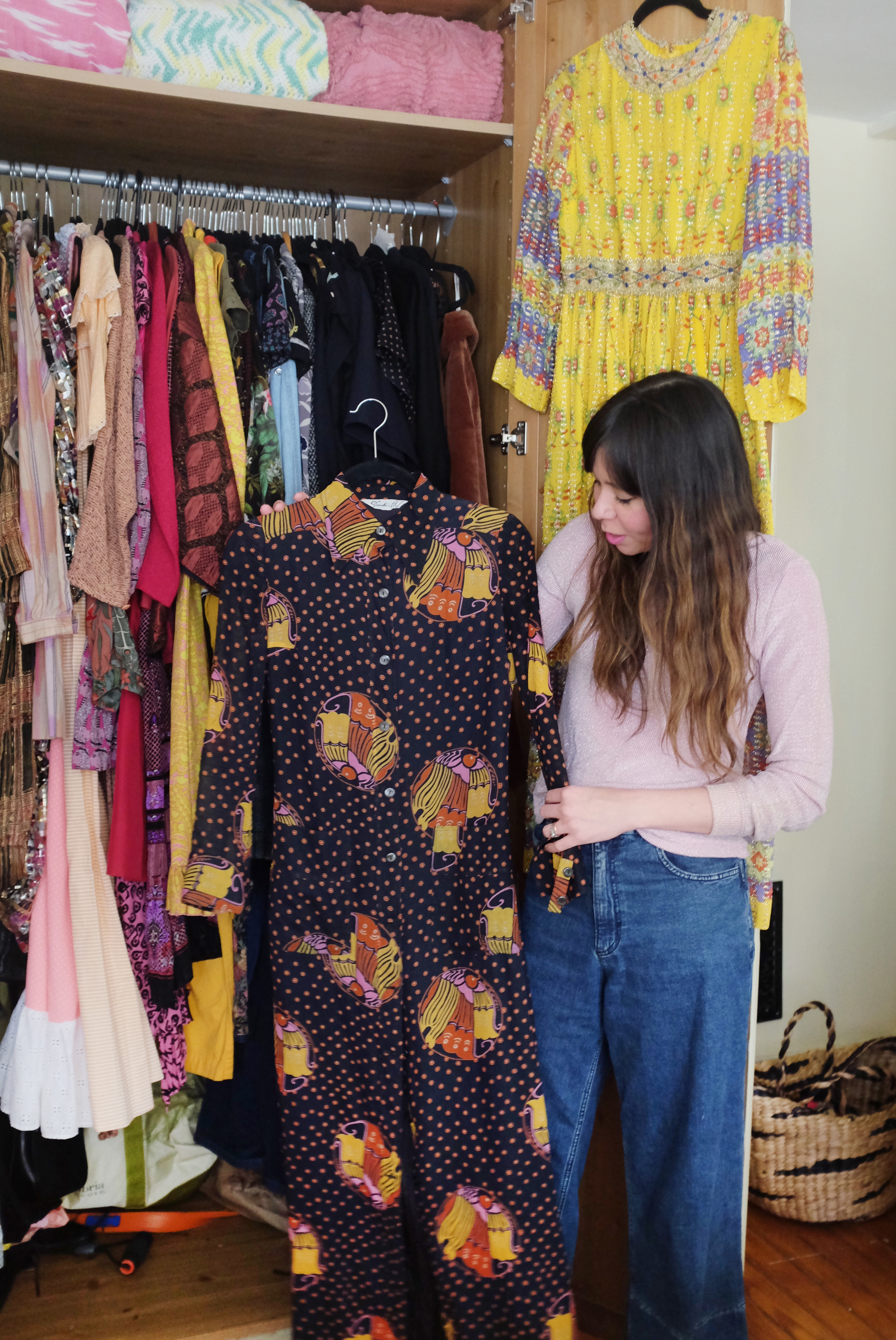 """Holding a vintage Italian dress; hanging is a dress I bought at Brimfield the year I had a clothing booth there."""