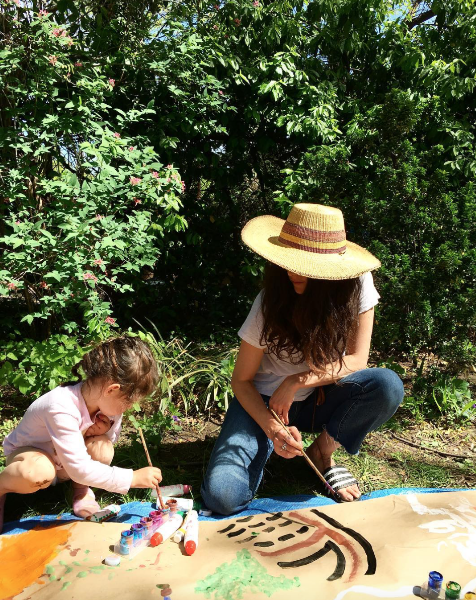 Lisa and her daughter painting in their Brooklyn Garden.