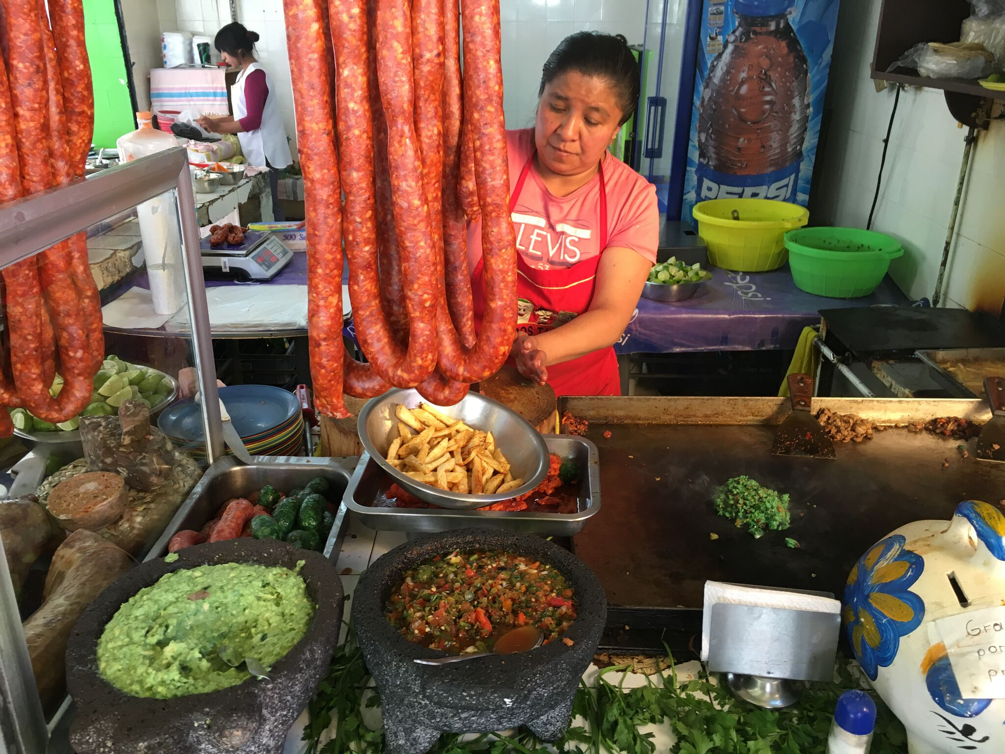 Making tacos de longaniza in Mexico City. Photo: Kiki