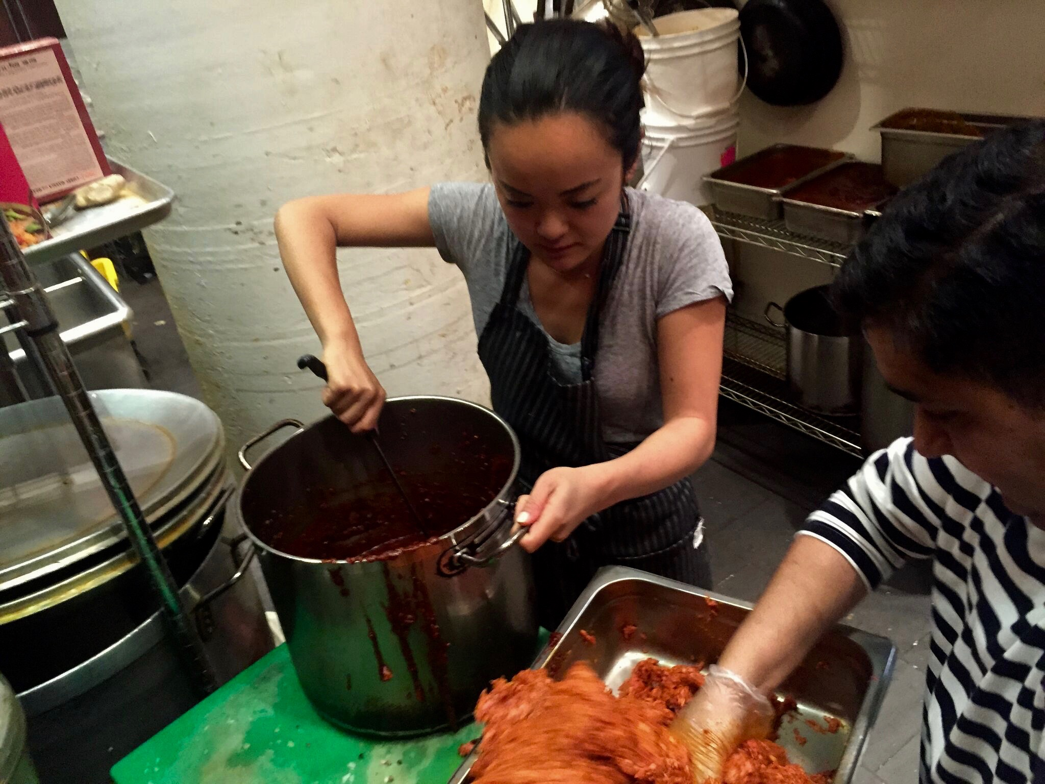 Kiki prepares longanisa for Terroir in Toronto, with the help of the cooks at Amaya, May 2015.
