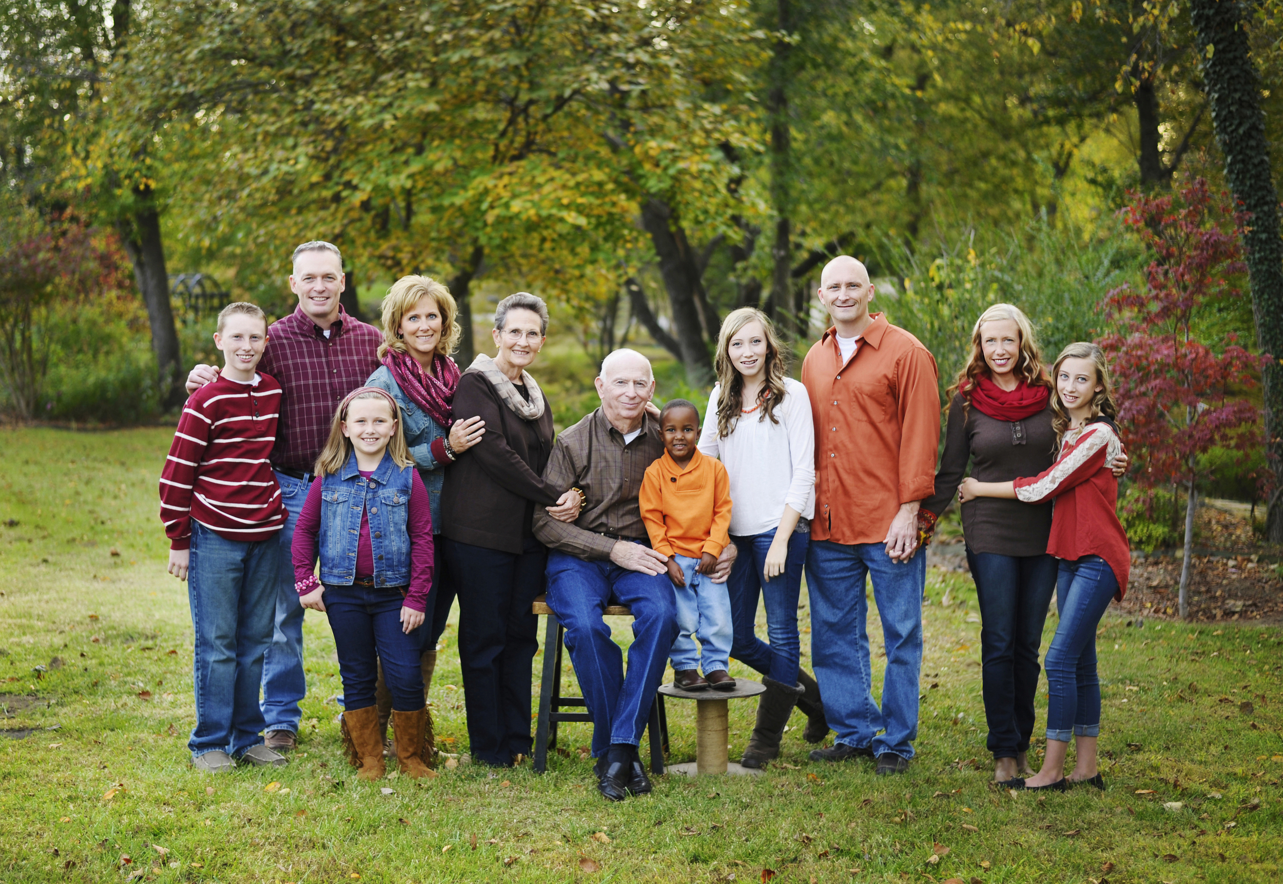 One of my most favorite things to   photograph is an extended family portrait because I think they're so important.  They can also be very tricky to coordinate outfits and make everyone happy.  This family photographed in the fall went with some great fall colors that really work well together.  They chose brown as their neutral color and orange and magenta as their accent colors.  I think it all worked perfectly and wardrobe didn't distract from the most important thing in this photo which is family and oh what a sweet family it is.  Good job everyone!
