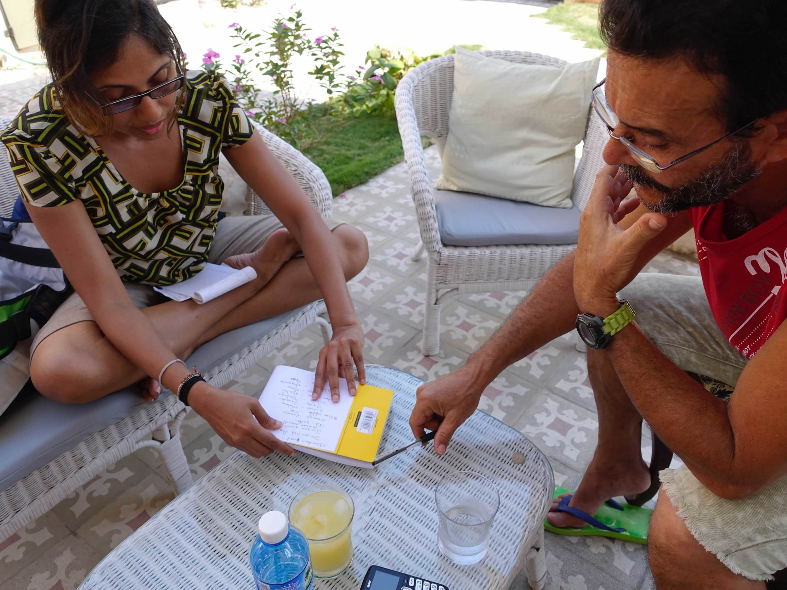 UBELONGER, Tharangi (l) works with a Cuban man, Rene to improve his English, while she polishes her Spanish skills.