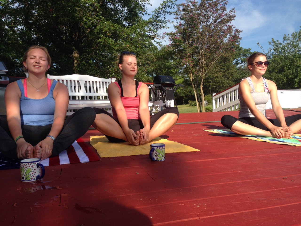 Judith, Sabine and Anna on the pool deck for morning yoga.