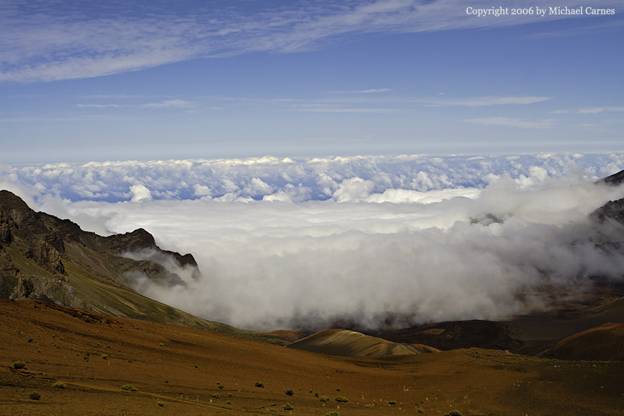 Clouds pour into the crater of Haleakala Volcano on Maui