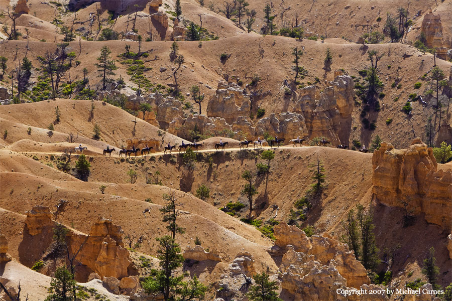 Riders on a distant Trail in Bryce Canyon