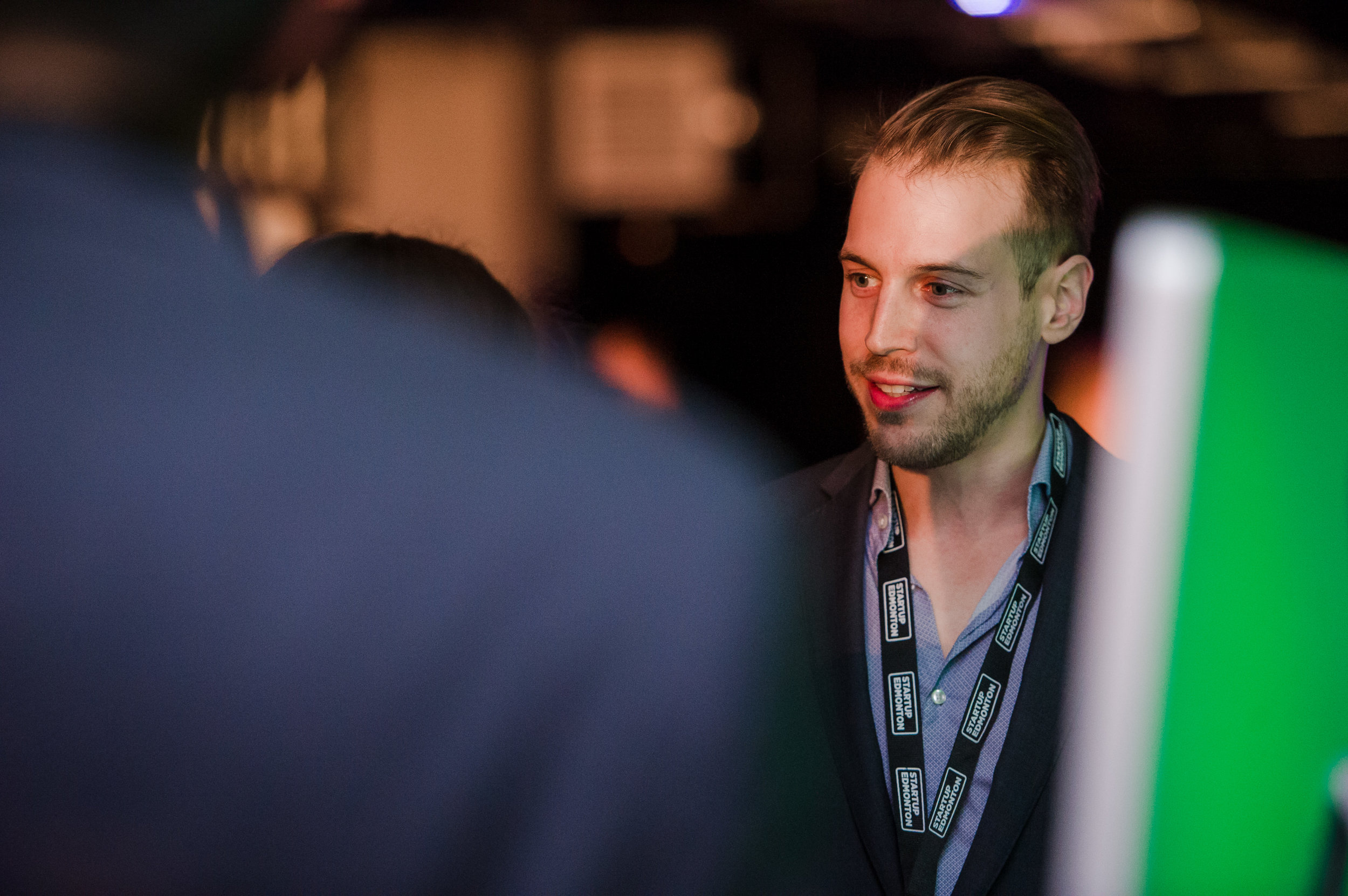 Amir Reshef, CEO and co-founder of dealcloser, chats with the crowd at Launch Party 7.