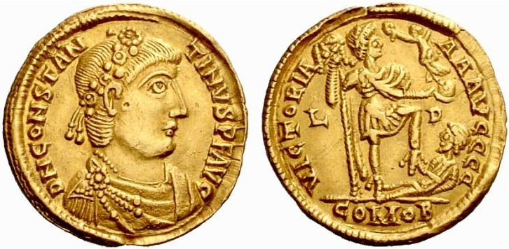 Gold solidus of Constantine III, minted at Lyon. The reverse shows him trouncing a fallen barbarian.