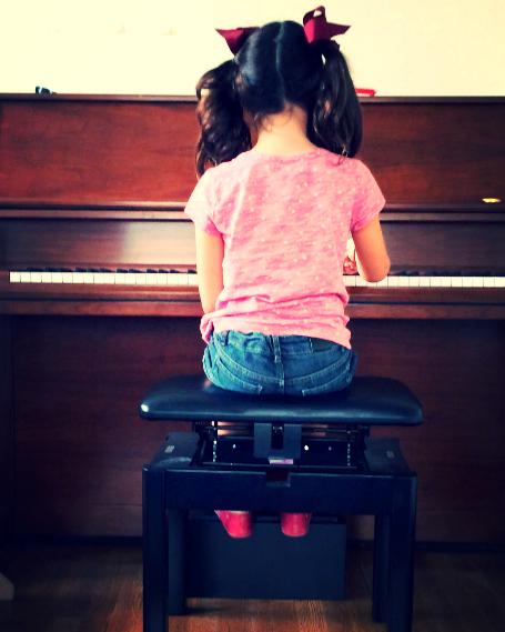 Juliet at piano.png