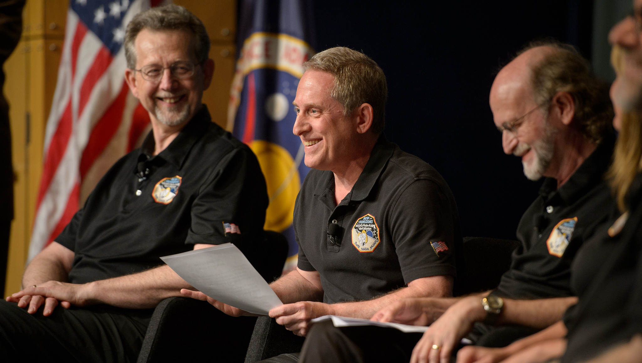 Alan Stern, principal director of the New Horizons mission, with members of his team.   NASA/Flickr  (CC BY-NC 2.0)