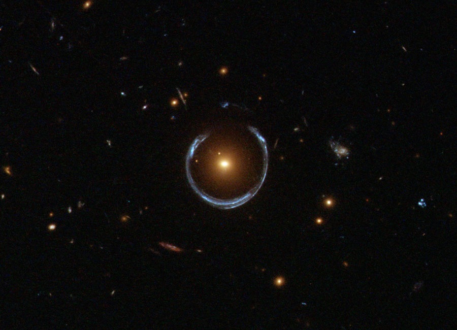 """An """"Einstein ring"""", which is a distorted image of a distant galaxy caused by gravitational lensing.  ESA/Hubble/NASA  (public domain)"""