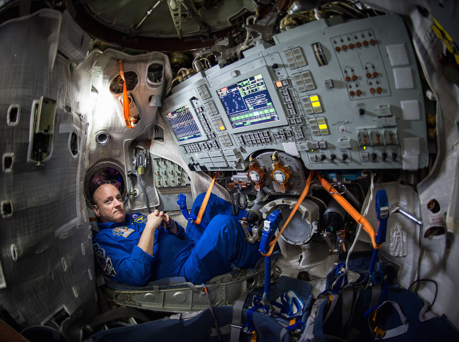 Astronaut Scott Kelly shows the cramped conditions within the Soyuz simulator.   NASA/Bill Ingalls/Flickr  (CC BY-NC-ND 2.0)