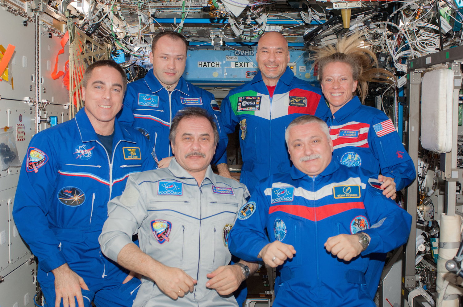 A different sort of family portrait. Astronauts Chris Cassidy, Pavel Vinogradov, Fyodor Yurchikhin, Alexander Misurkin, Luca Parmitano and Karen Nyberg are part of a community of scientists all working together to push the boundaries of exploration.   NASA Johnson/Flickr  (CC BY-NC 2.0)