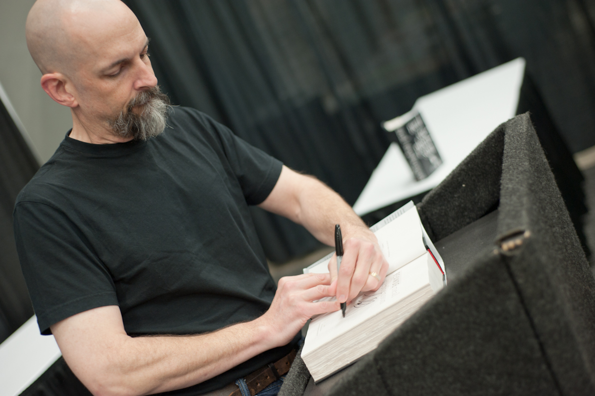 Neal Stephenson at a book signing at GDC Online in 2011.  GDC Online/Flickr  (CC BY 2.0)
