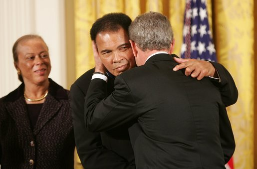 Muhammad Ali, here receiving the Presidential Medal of Freedom in 2005, lived publicly with Parkinson's disease for decades.   Paul Morse/Wikimedia Commons  (public domain)