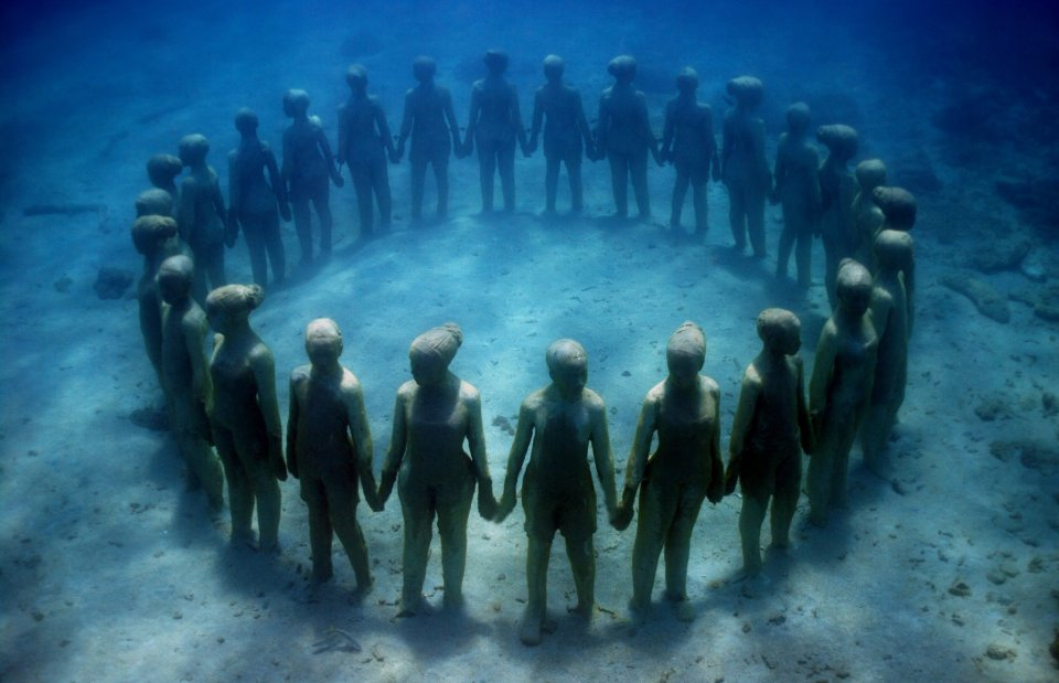 Jason deCaires Taylor's circle of underwater guardians is providing much-needed relief for the reef in which it stands. © Jason deCaires Taylor  (used with artist's permission)