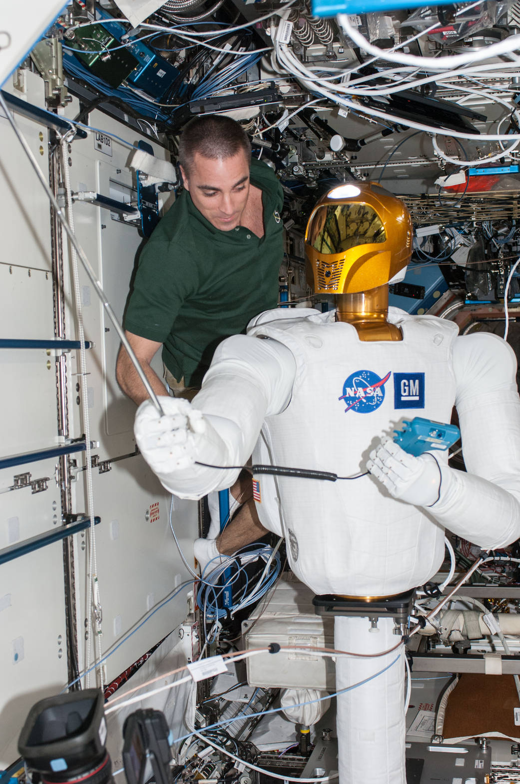 Astronaut Chris Cassidy with the Robonaut 2 aboard the International Space Station. More TARS than HAL, this was the first humanoid robot in space.  NASA  (public domain)