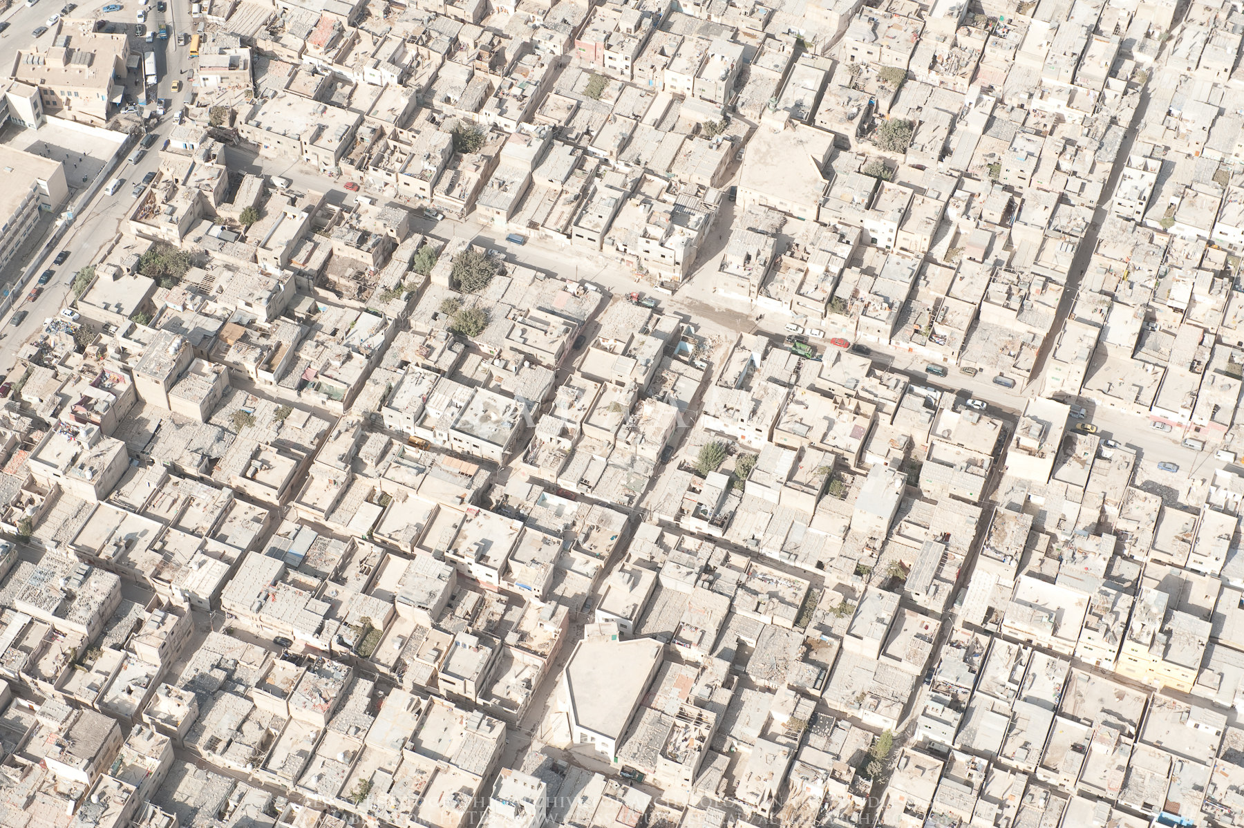 Crowded conditions in refugee camps can overburden support services and infrastructure, alongside all the problems caused by household crowding.   Aerial Photographic Archives for Archaeology in the Middle East/Flickr  (CC BY-NC-ND 2.0)