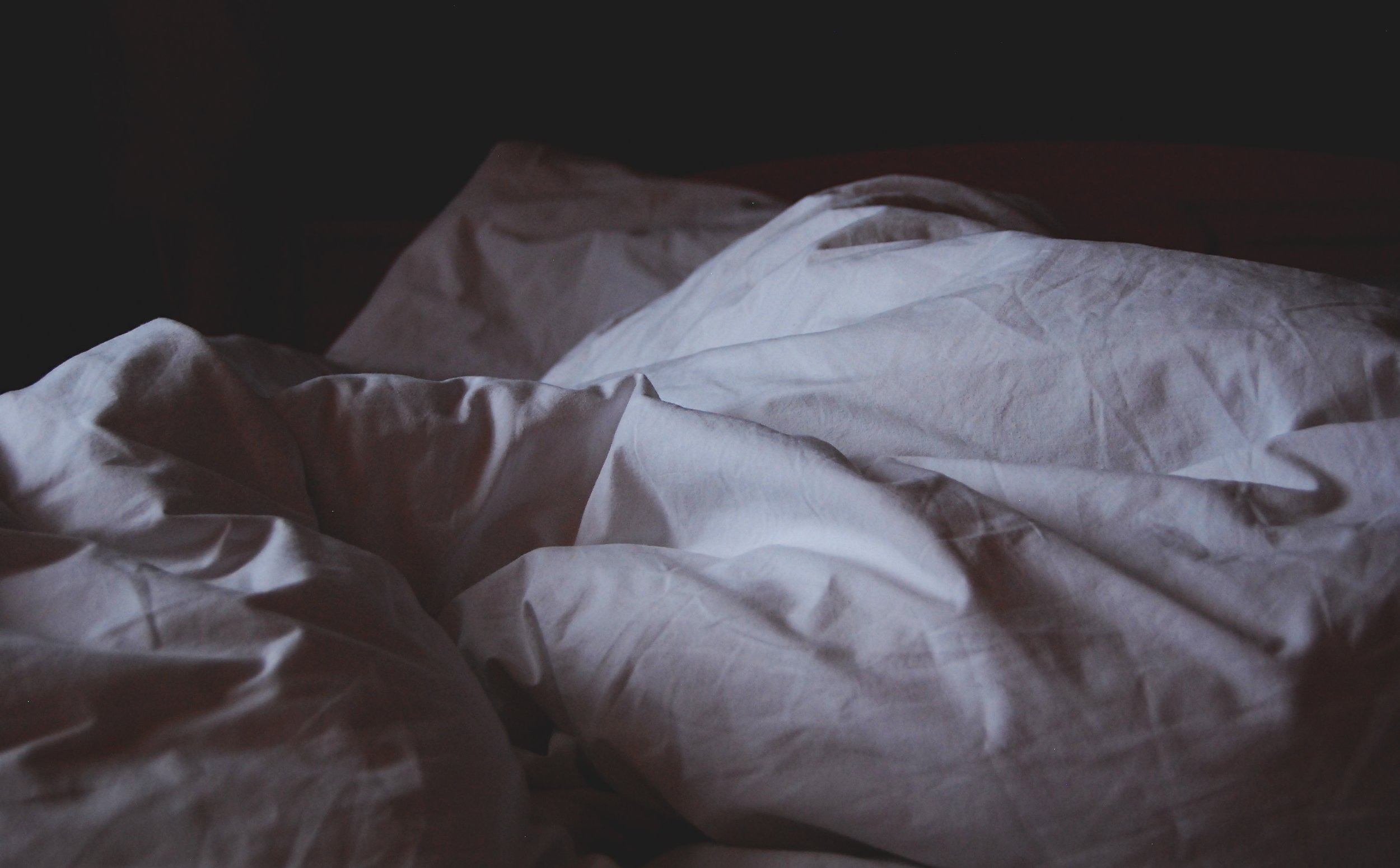 We spend a lot of our time under the sheets, but still don't fully understand why.   Krista Mangulsone/Unsplash  (CC0 1.0)