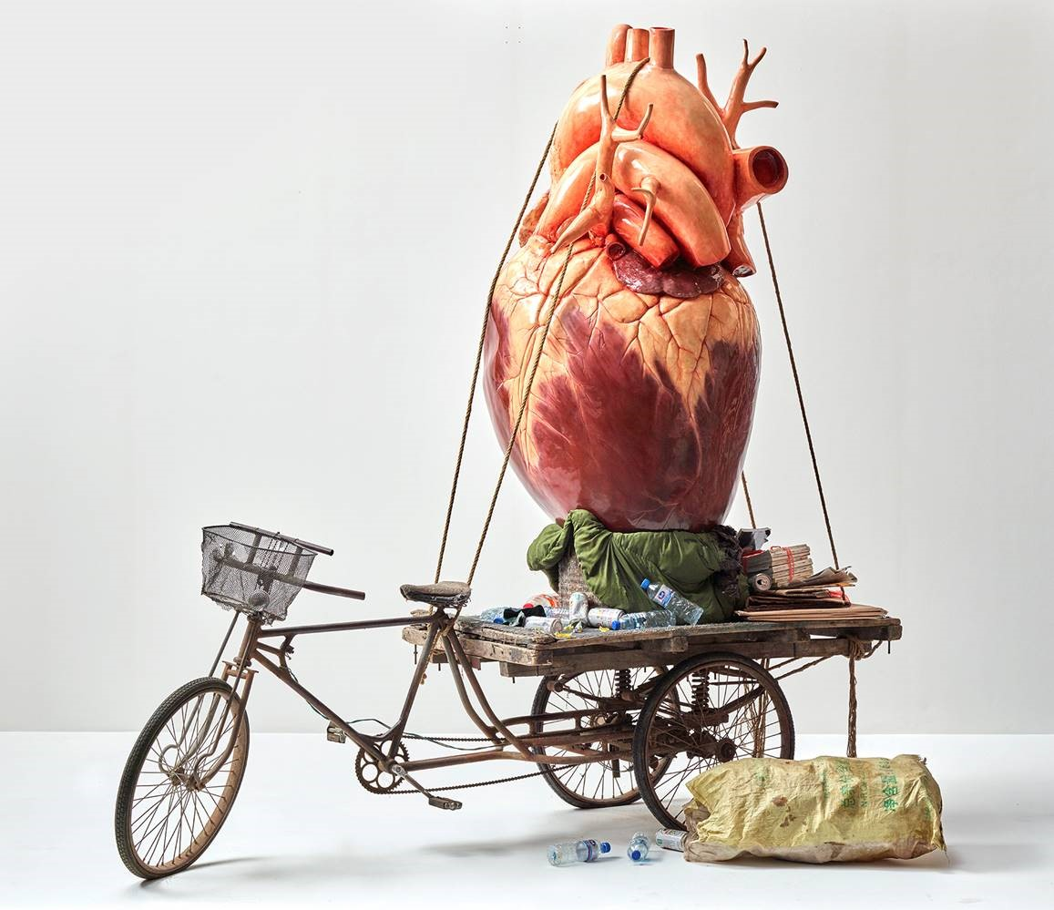 In his work Recycling, Bao Yiluo mounted an enormous fibreglass heart on a San Lun Che, a tricycle often used to transport rubbish in China.  ©    Bao Yiluo & White Rabbit Collection Sydney (used with permission)
