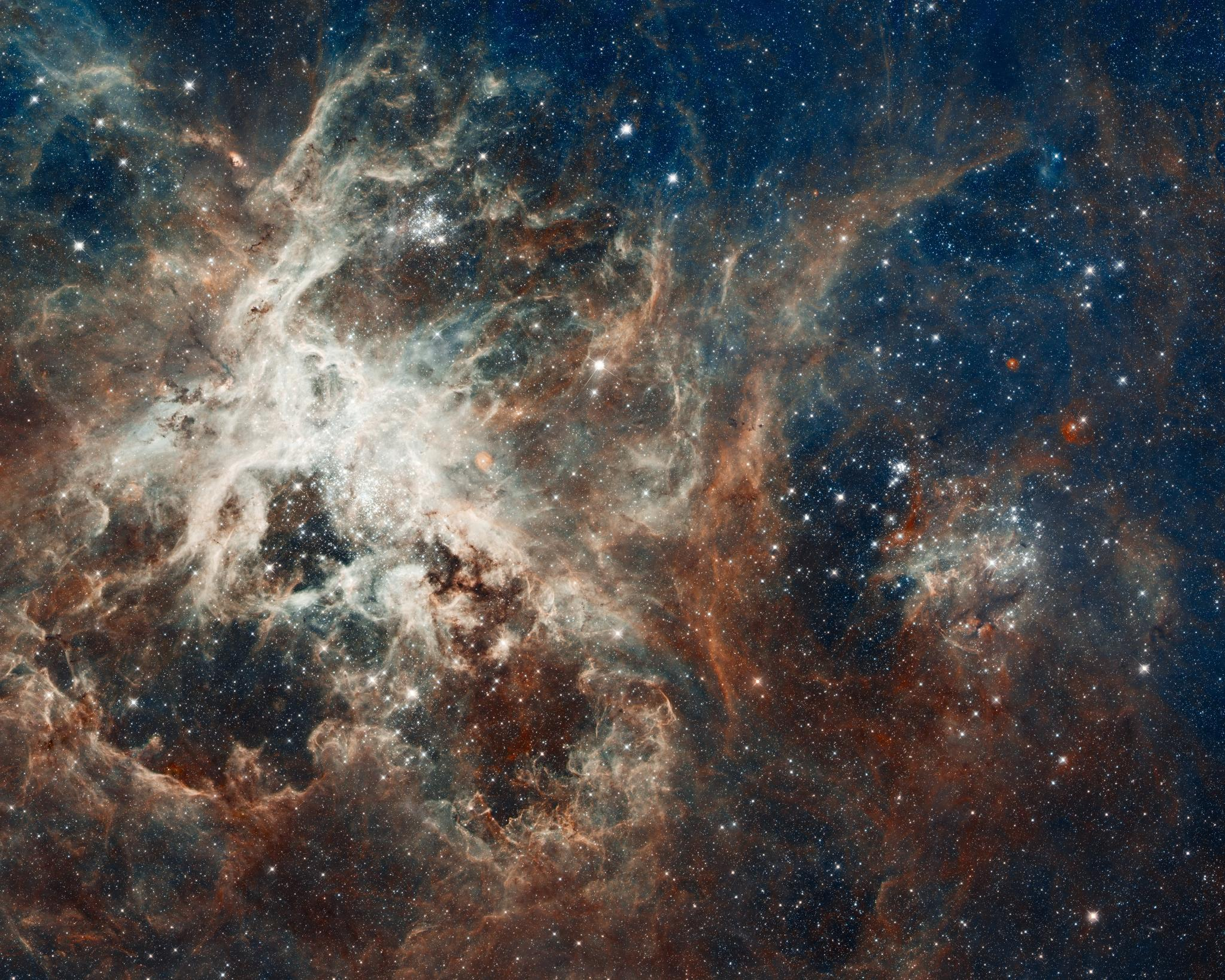 Our knowledge of space has come a long way since Copernicus and Galileo first claimed that our solar system is heliocentric. Continued funding of space research has allowed for images like this one, taken by the Hubble telescope, showing celestial bodies 170,000 light-years away from Earth.   NASA/Flickr  (CC BY 2.0)