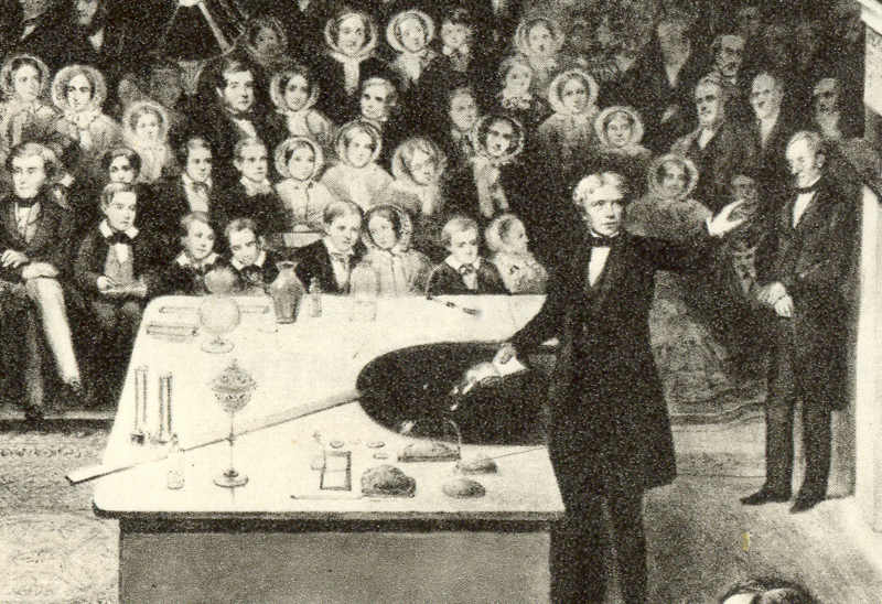 "The self-funded scientists of the 18th and 19th centuries were called ""gentlemen scientists"", such as Michael Faraday  —  shown above giving the British Royal Institution's Christmas Lecture for Juveniles in 1856  —  who had no formal training before becoming a full Professor of Chemistry.  Alexander Blaikley/ London Illustrated News  (public domain)"
