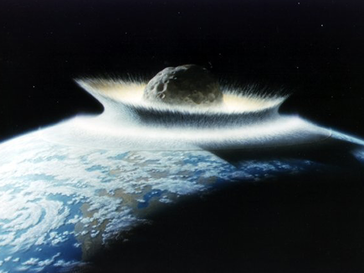 If a large asteroid or comet struck the Earth in or near the ocean, it would have triggered an apocalyptic tsunami.   Don Davis/NASA  (public domain)