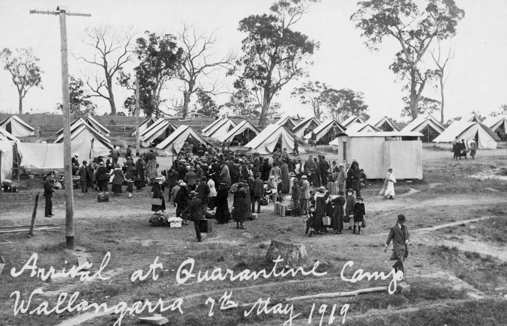 People with suitcases arrive at the Wallangarra Quarantine Camp during the Spanish Flu epidemic in 1919 .  State Library of Queensland/Flickr  (No known copyright restrictions)