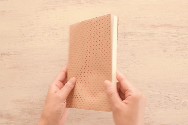 Step 5: Wrap the paper around your book.