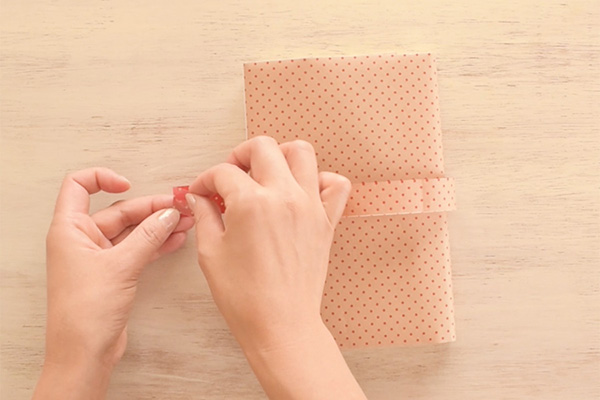 Step 11: Put the paper belt through the slit, cut the ends and close with a glue dot.