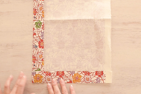 Step 3: Turn the paper 90 degrees clockwise, then fold up the paper.