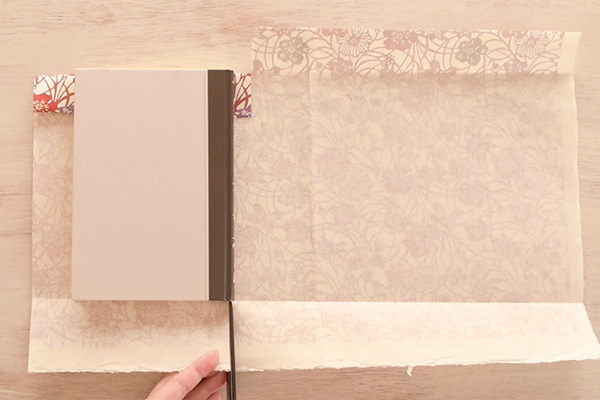 Step 9: Cut a slit at the corner of the book.