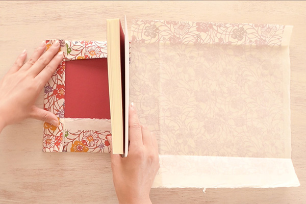 Step 12: Fold up all the creases to close one side of the book.