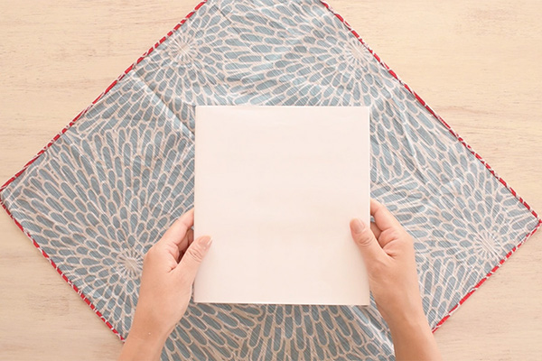 Step 1: Place your Furoshiki (square fabric) upside down in diagonal position.