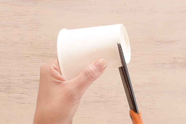 Step 1: Cut the bottom and top of the paper cup to make a template.