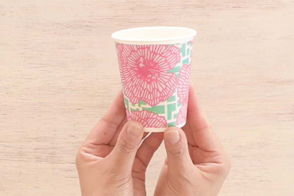 Step 4: Wrap the the paper around the paper cup then close the ends with double sided tape.